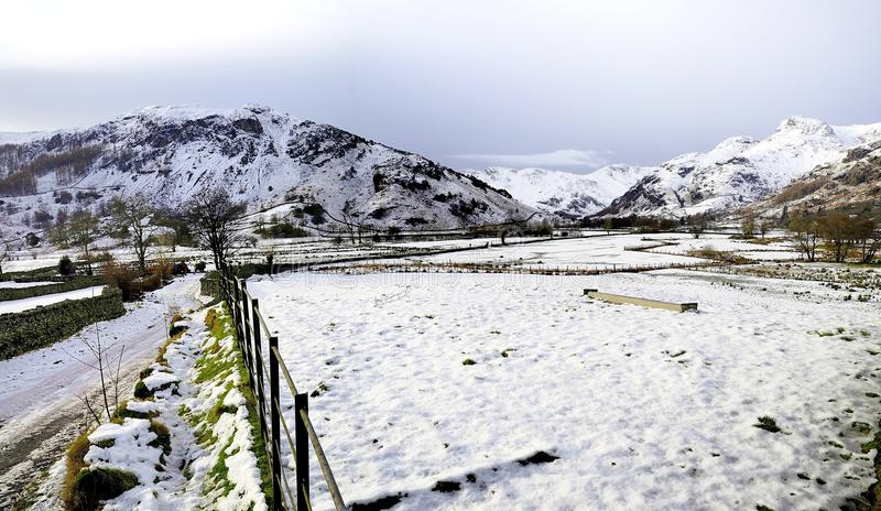 Snow over the Langdale valley. Winter in the Great Langdale Valley royalty free stock images