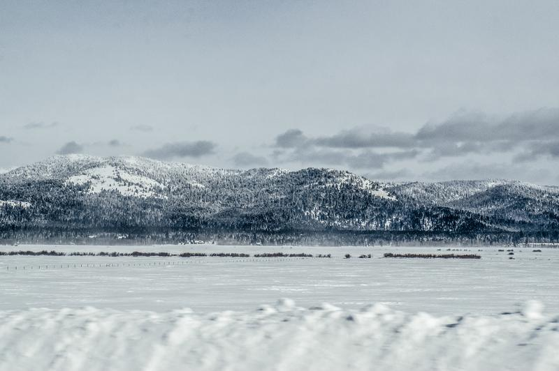 Snow drifting road, highway 20, Island park, Idaho royalty free stock images