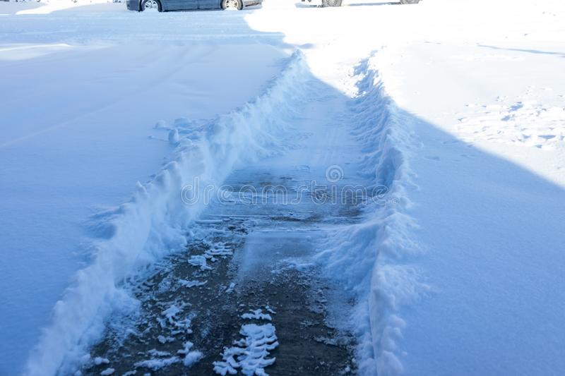 Snow path cleared on Driveway after snow storm. In Canada stock photo