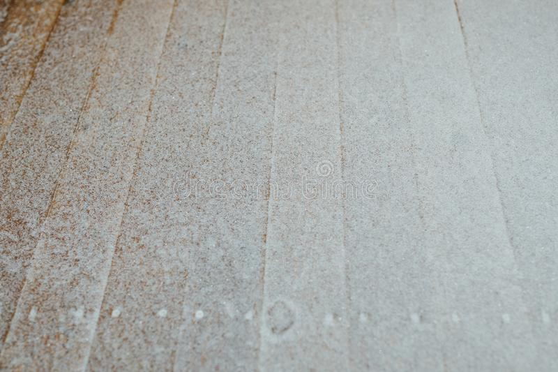 Snow patina on wooden lags background. With copy-space royalty free stock images