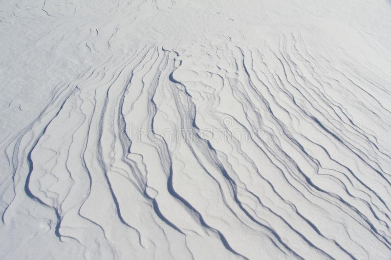 Snow patterns on the lake ice in winter stock photography