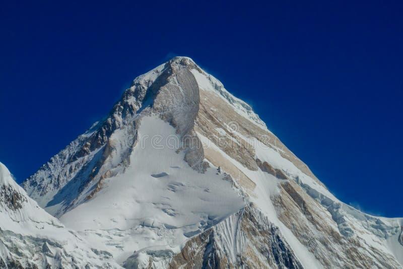 Snow peak of Khan Tengri mountain. Tian Shan mountains snow peaks and steep slopes in Kazakhstan and Kyrgyzstan. South Inilchek, Enilchek Khan Tengri and Pobeda royalty free stock image