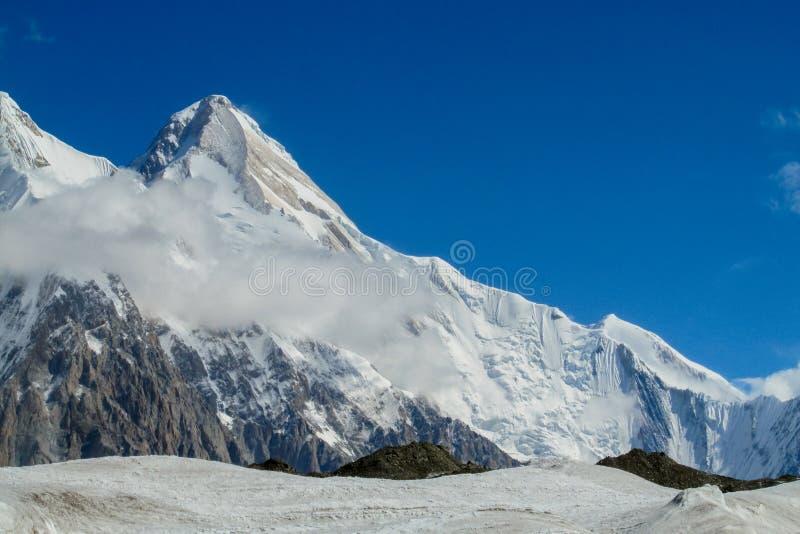 Snow peak of Khan Tengri mountain. Tian Shan mountains snow peaks and steep slopes in Kazakhstan and Kyrgyzstan. South Inilchek, Enilchek Khan Tengri and Pobeda stock images