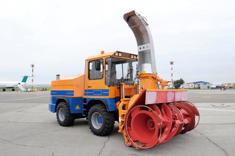 Snow plough in Airport. This photograph represent a snow ploughs ready to clear snow and ice on one of the Airport runways stock photo