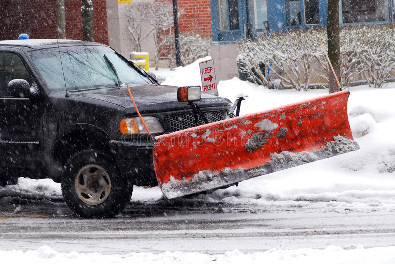 Snow plow. Truck on a road during a snowstorm