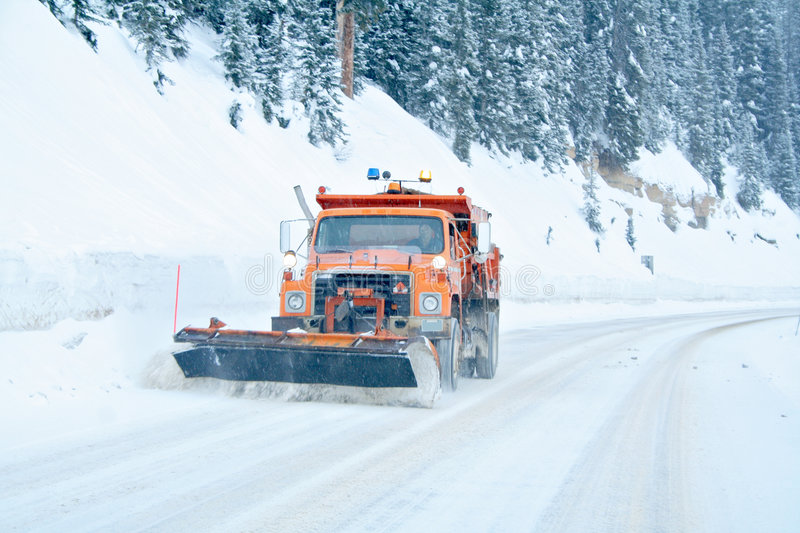 Snow Plow. Removing snow from mountain highway royalty free stock photos