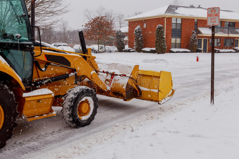 Snow plow doing removal after a blizzard stock photos
