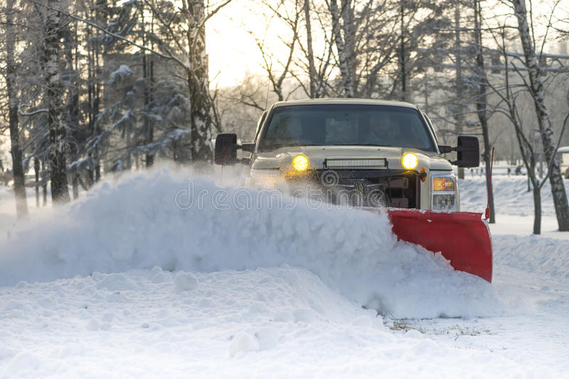 Snow plow doing snow removal after a blizzard stock image