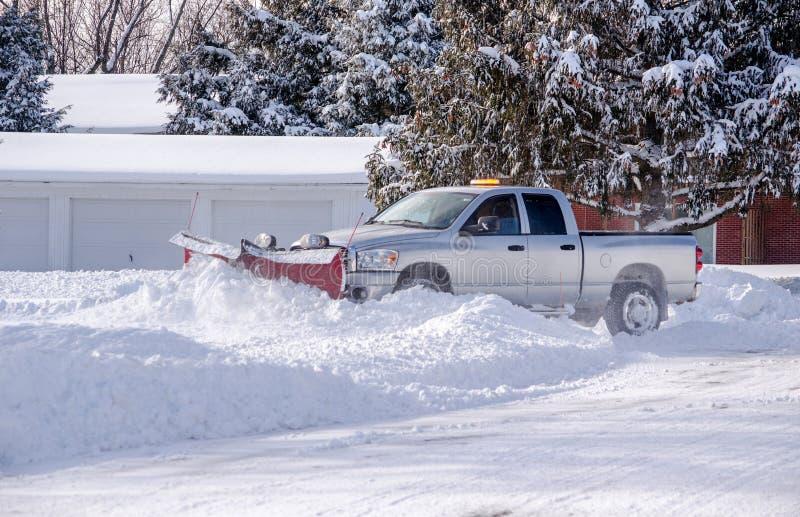 snow plow at work in Michigan USA stock photos