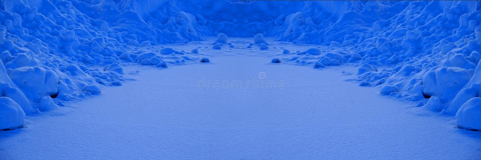 Snow Plowed From Road Into a Pile with Freshly Fallen royalty free stock photography