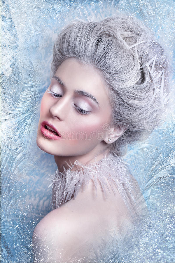 Snow Queen.Fantasy girl portrait. Winter fairy portrait.Young woman with creative silver artistic make-up. Winter Portrait. royalty free stock photography