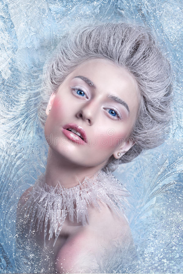 Snow Queen.Fantasy girl portrait. Winter fairy portrait.Young woman with creative silver artistic make-up. Winter Portrait. Studio royalty free stock photography