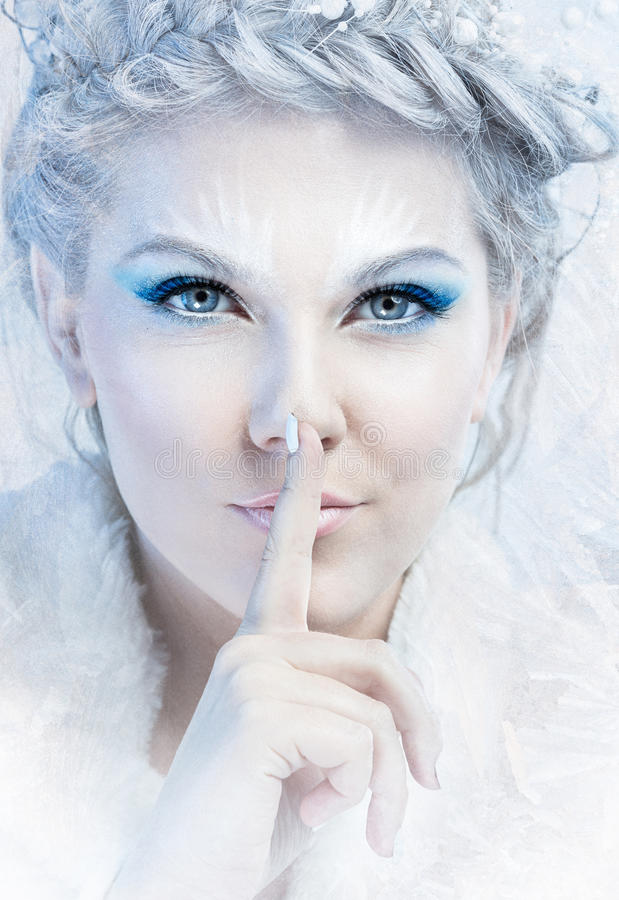 Snow queen. With a finger over mouth royalty free stock images