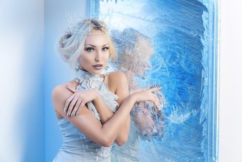 Snow queen near frozen mirror royalty free stock photos