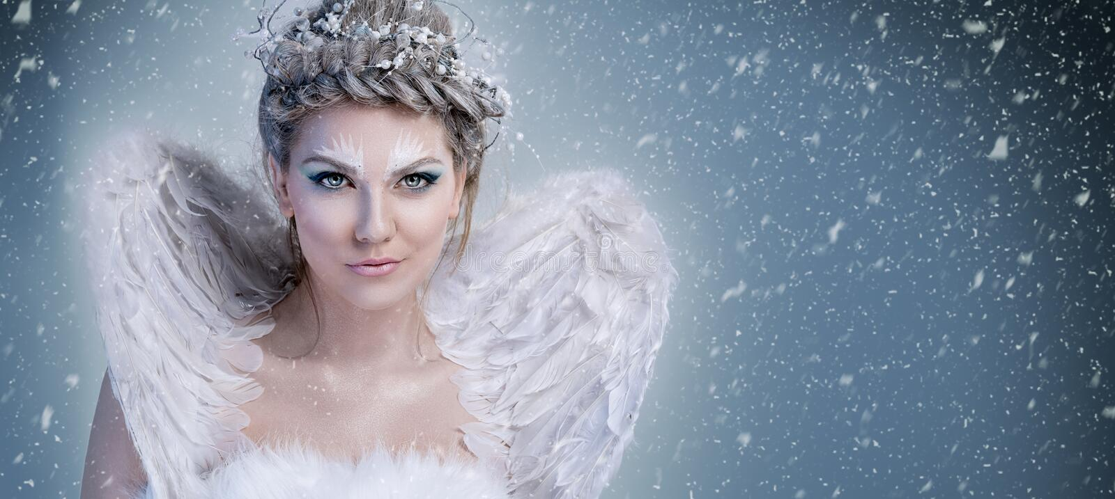 Snow queen - winter fairy with wings royalty free stock photography