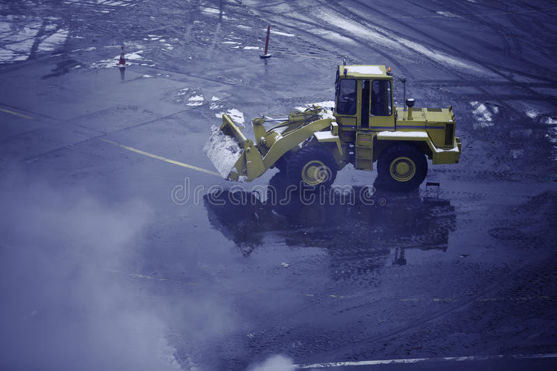 Snow removal. Oppression at the airport royalty free stock image