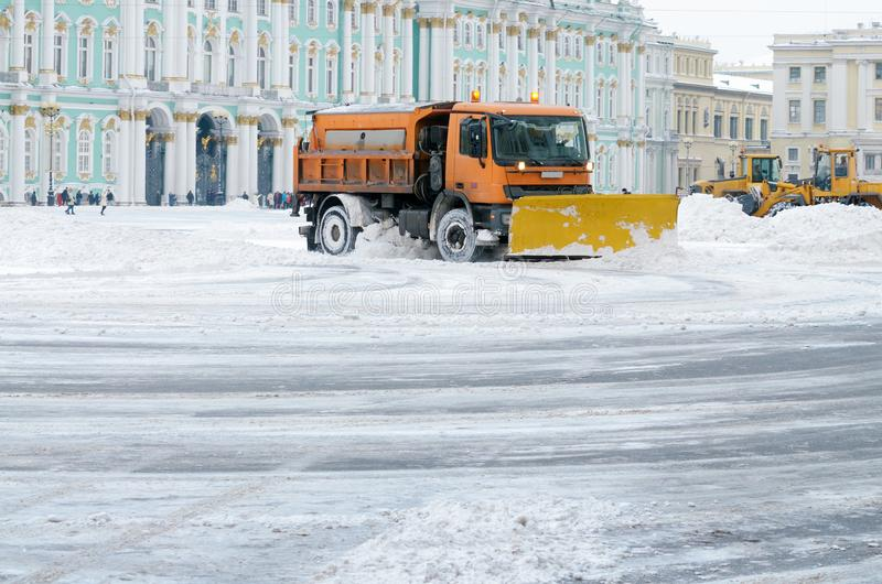 Snow-removal vehicles on the streets royalty free stock photos