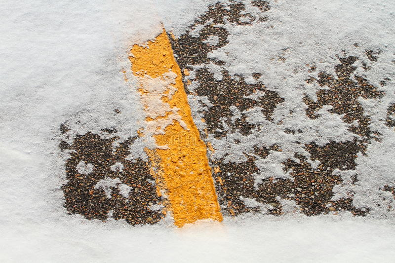 Snow on the road background. White snow patch on the road stock images