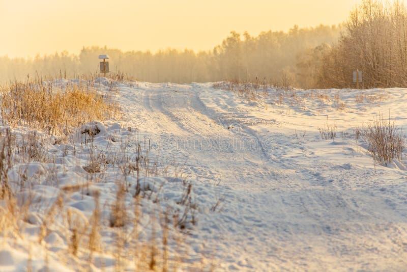 Snow road at sunrise_7 stock photos