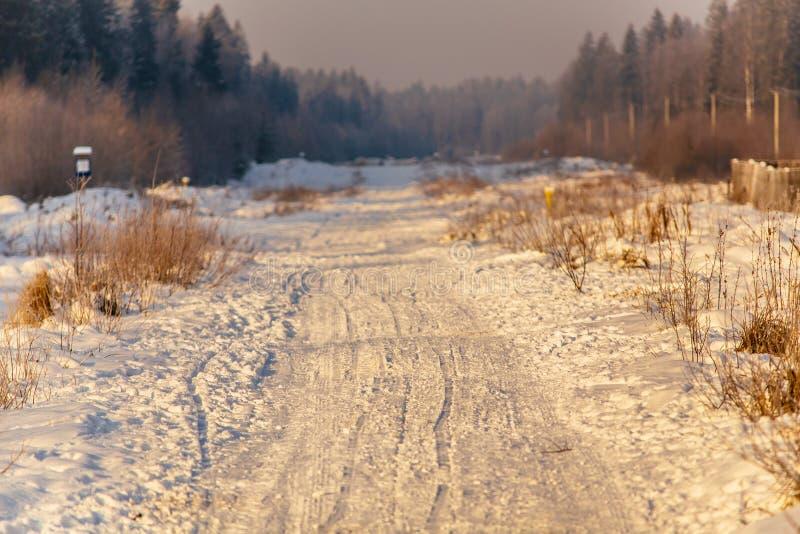 Snow road at sunrise_4 stock photo