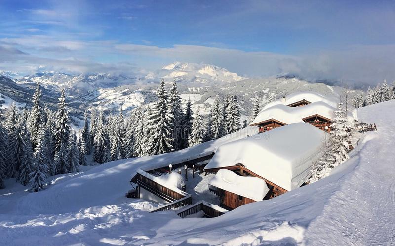 Snow`s cap on mountain hut - Flachau, Austria stock images