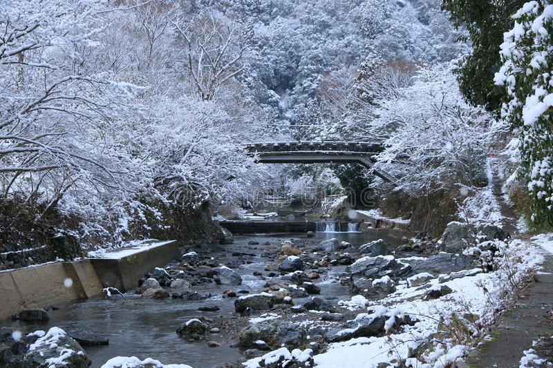 Snow scene of Kiyotaki river, Kyoto. This is a snow scene of Kiyotaki river in suburbs of Kyoto. It snowed for the first time in this winter.it was wholly silent stock image