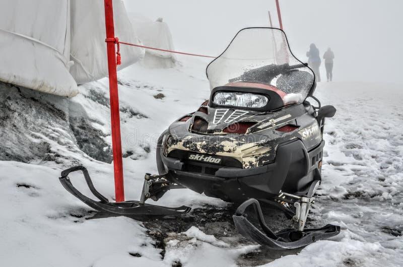 Snow scooter. Snow vehicle. Ski-doo royalty free stock photos