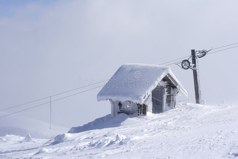 Snow shelter on mountain top royalty free stock image