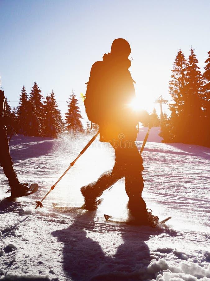 Snow shoe walking sillhouette stock photo