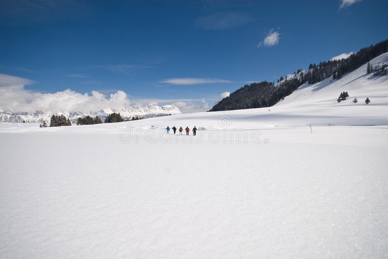 Snow shoeing royalty free stock image