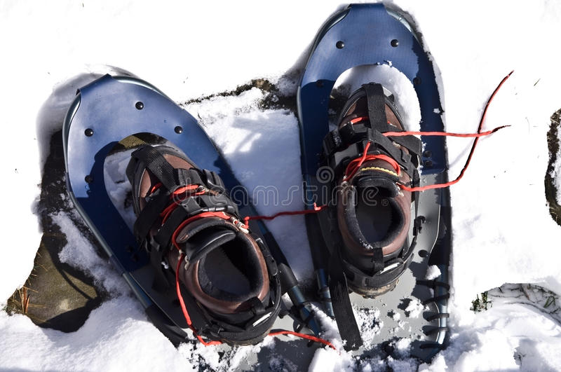 Snow Shoes with Boots royalty free stock photography