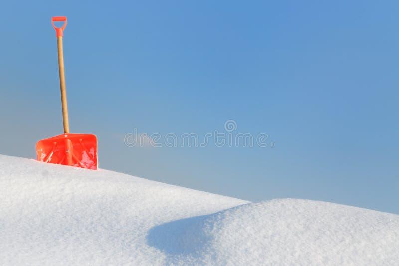 Snow shovel royalty free stock image