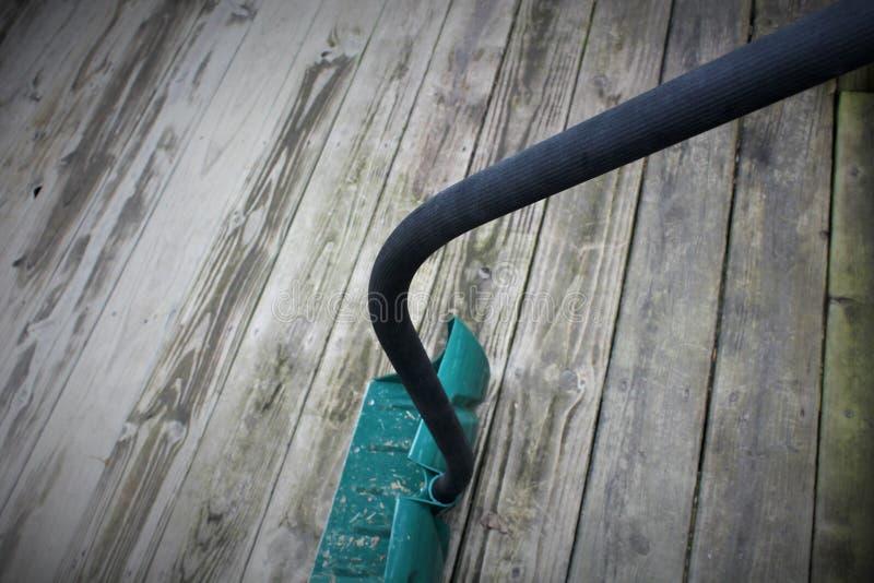 Snow shovel on wood Slat. Snow shovel on old wooden slat royalty free stock photography