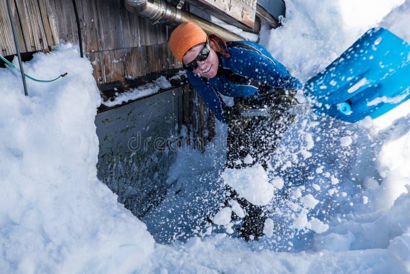 Snow shoveling royalty free stock photography