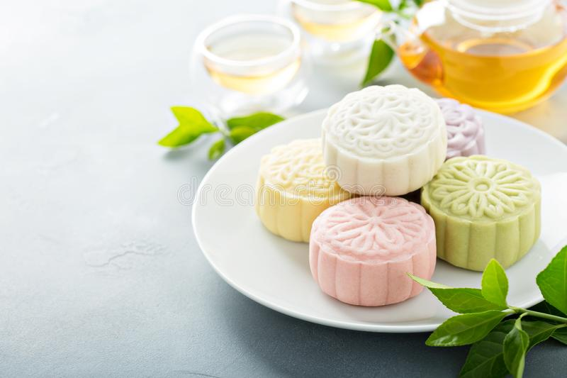 Snow skin sweet and savory traditional Chinese mooncakes. With variety of fillings and green tea royalty free stock images