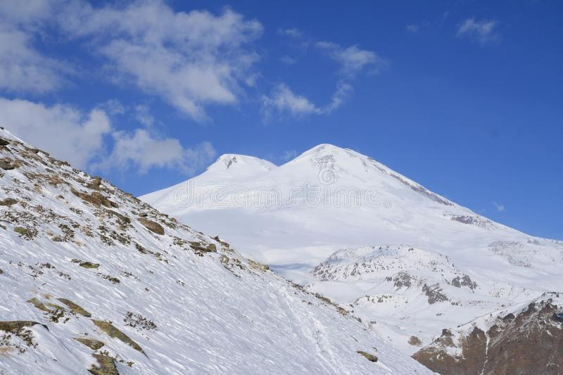 Snow at the slopes of North Caucasus and two-headed Mount Elbrus stock photos
