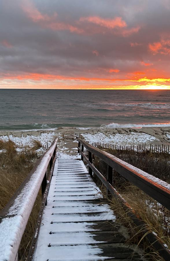 A Snow Squall at Sunset on the Beach stock photos