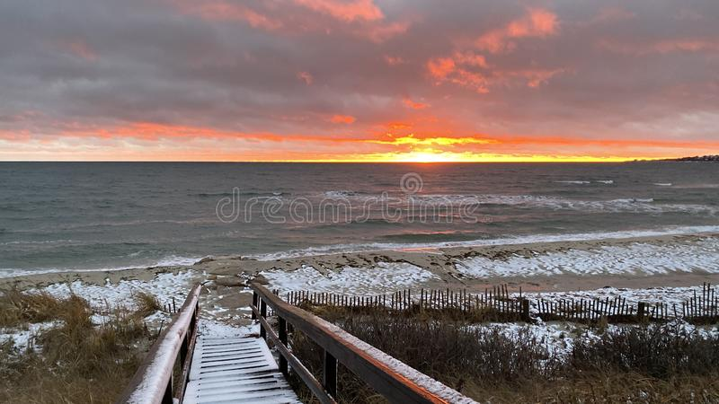 A Snow Squall at Sunset on the Beach royalty free stock photos