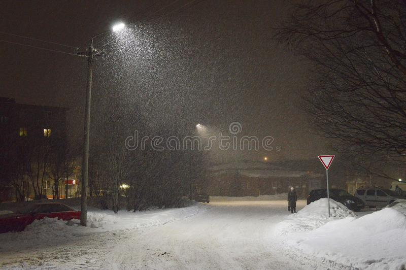Snow-storm in city in polar night. stock image