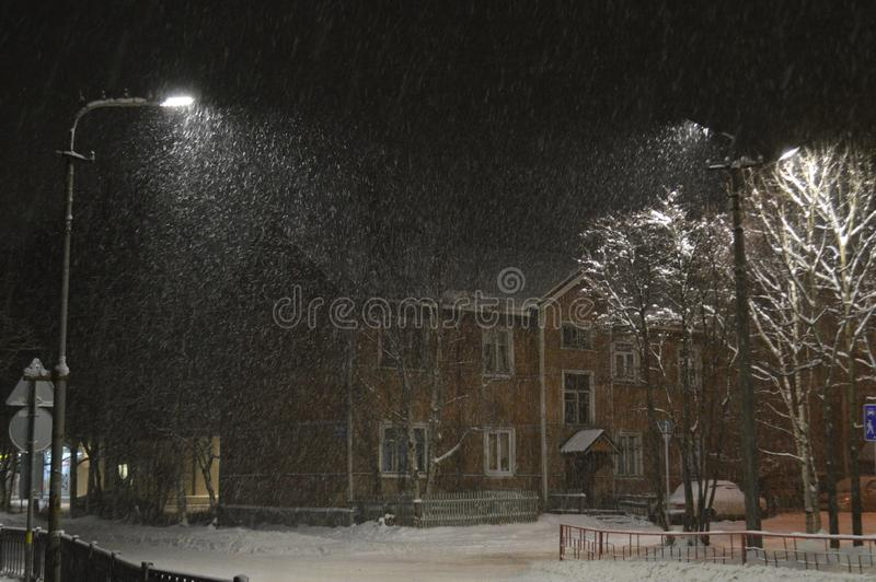 Snow-storm in city in polar night. Landscape with street in polar night stock images