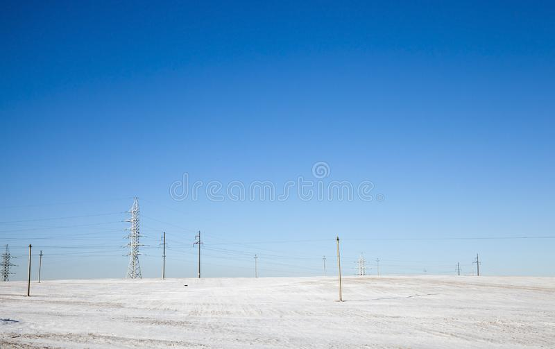 Snow Sunny snow electric poles royalty free stock images
