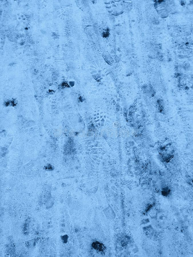 Snow texture with footprints stock image