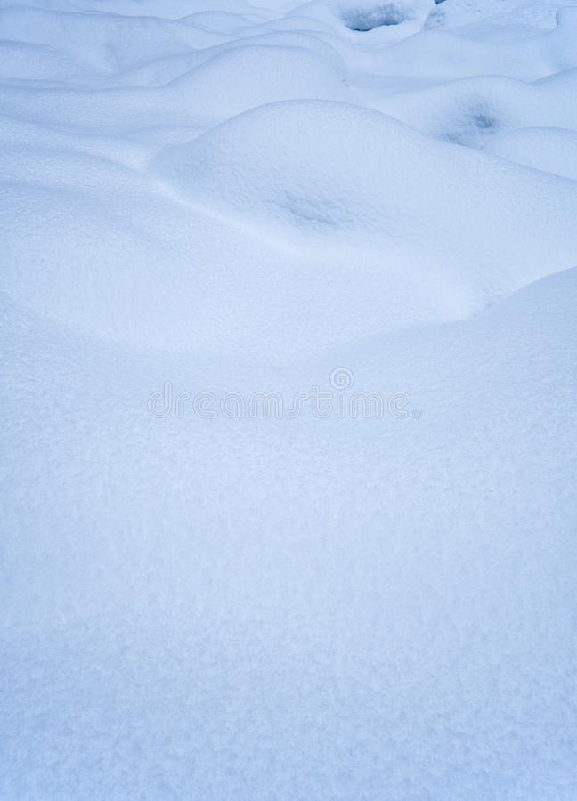 Snow texture. Natural winter background with snow waves.  royalty free stock photo