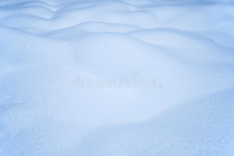 Snow texture. Natural winter background with snow waves.  stock photo