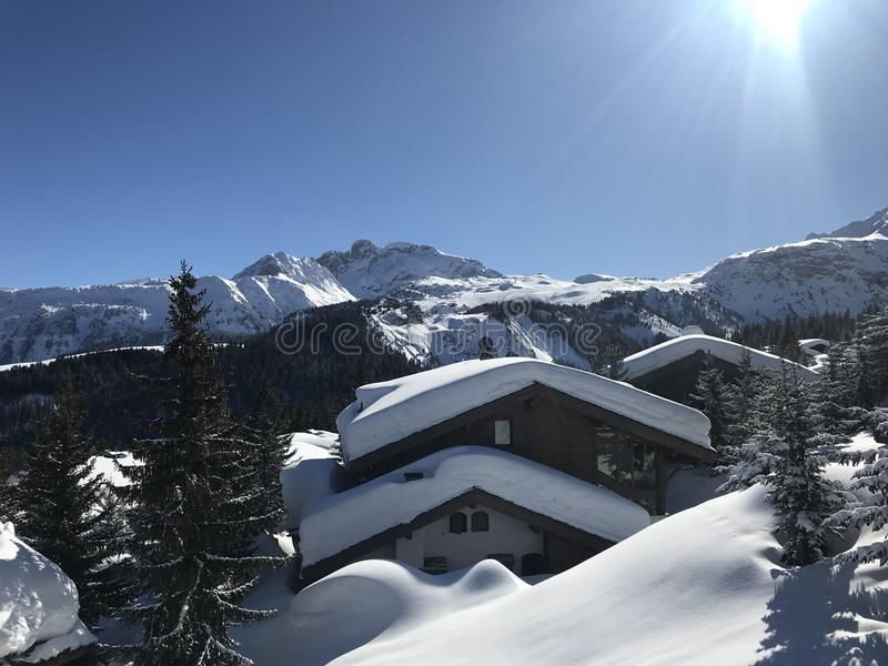 Snow top chalets. And mountains in sunny beautiful Courchevel France, skiing resort royalty free stock images