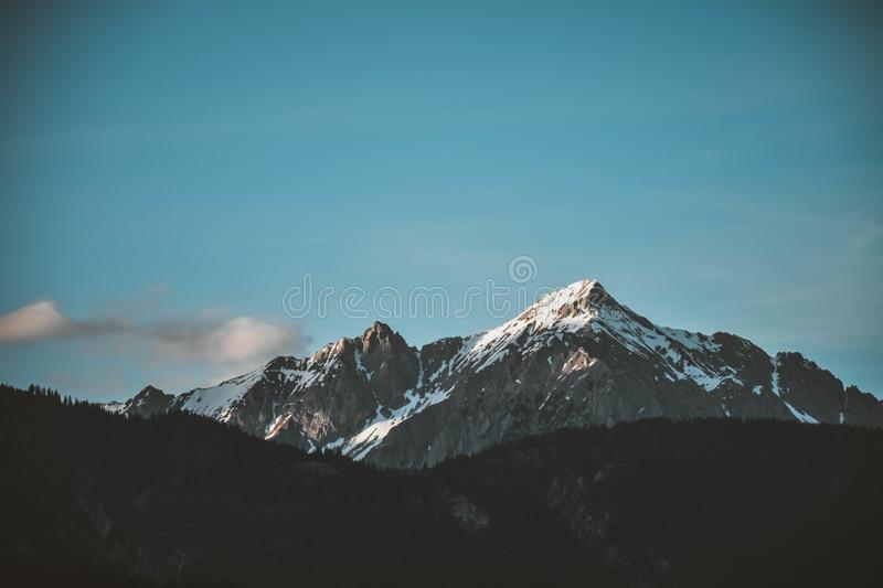 Snow-top Mountain Under Clear Sky royalty free stock image