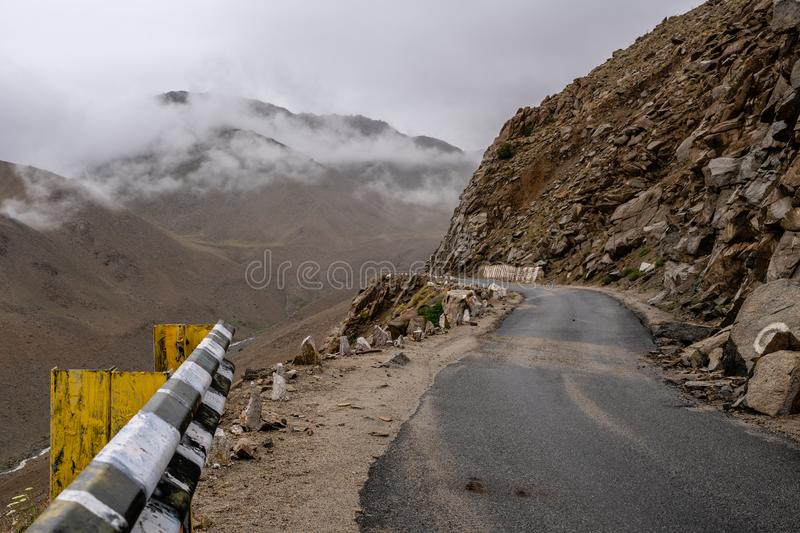 Snow on top of mountains at Khardung La Pass Highest road of The World. Khardung La Pass Highest road of The World Leh, Ladakh, Jammu and Kashmir, India royalty free stock image