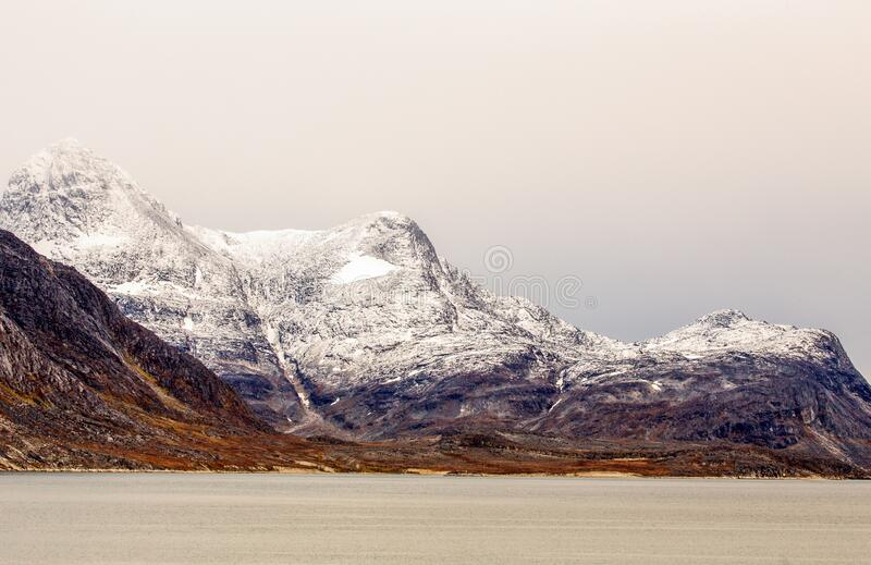 Snow topped mountains with Ukkusissat Little Malene peak and sea in the foreground, Nuuk, Greenland stock photos