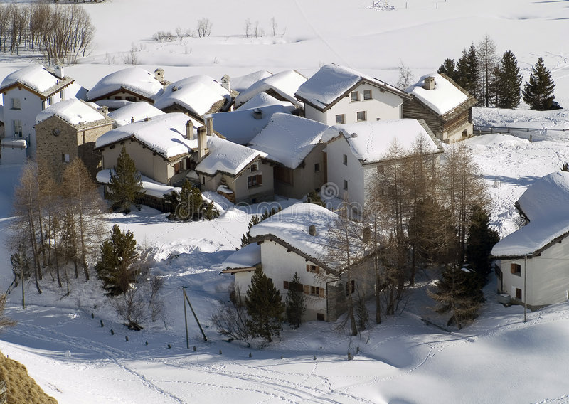 Snow village. Houses snow in the Alps (italy stock photography