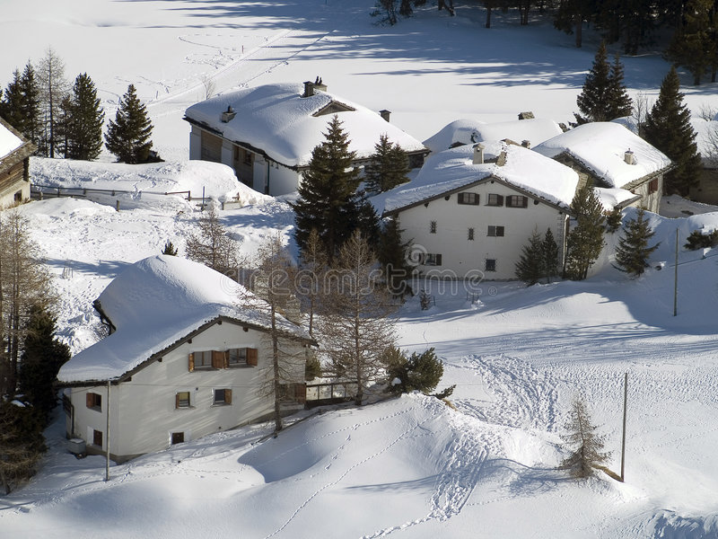 Snow village. Houses snow in the Alps (italy stock images